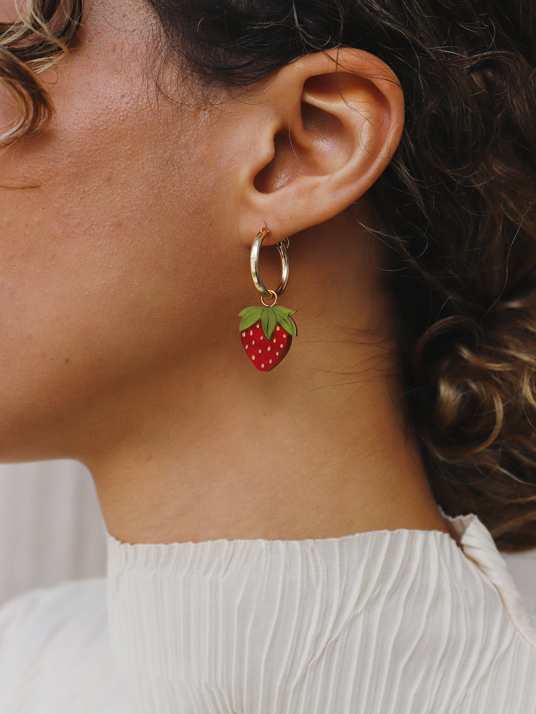 Mini strawberry earrings made from acrylic and wood with 14k gold-filled hoops. Statement jewellery handmade in the U.K. by Wolf & Moon.