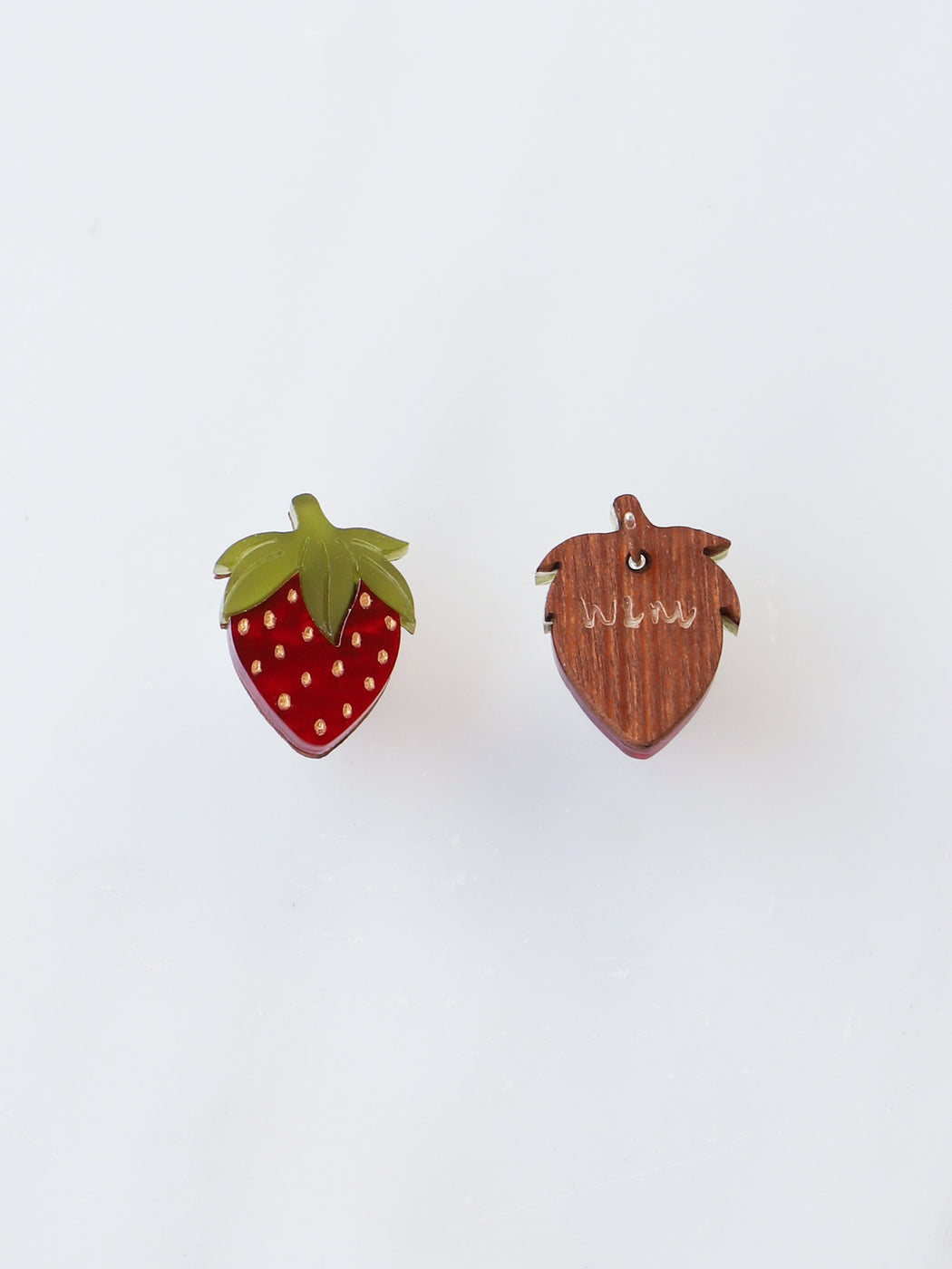 Mini strawberry studs made from acrylic and wood with hand-inked details. Statement jewellery handmade in the U.K. by Wolf & Moon.