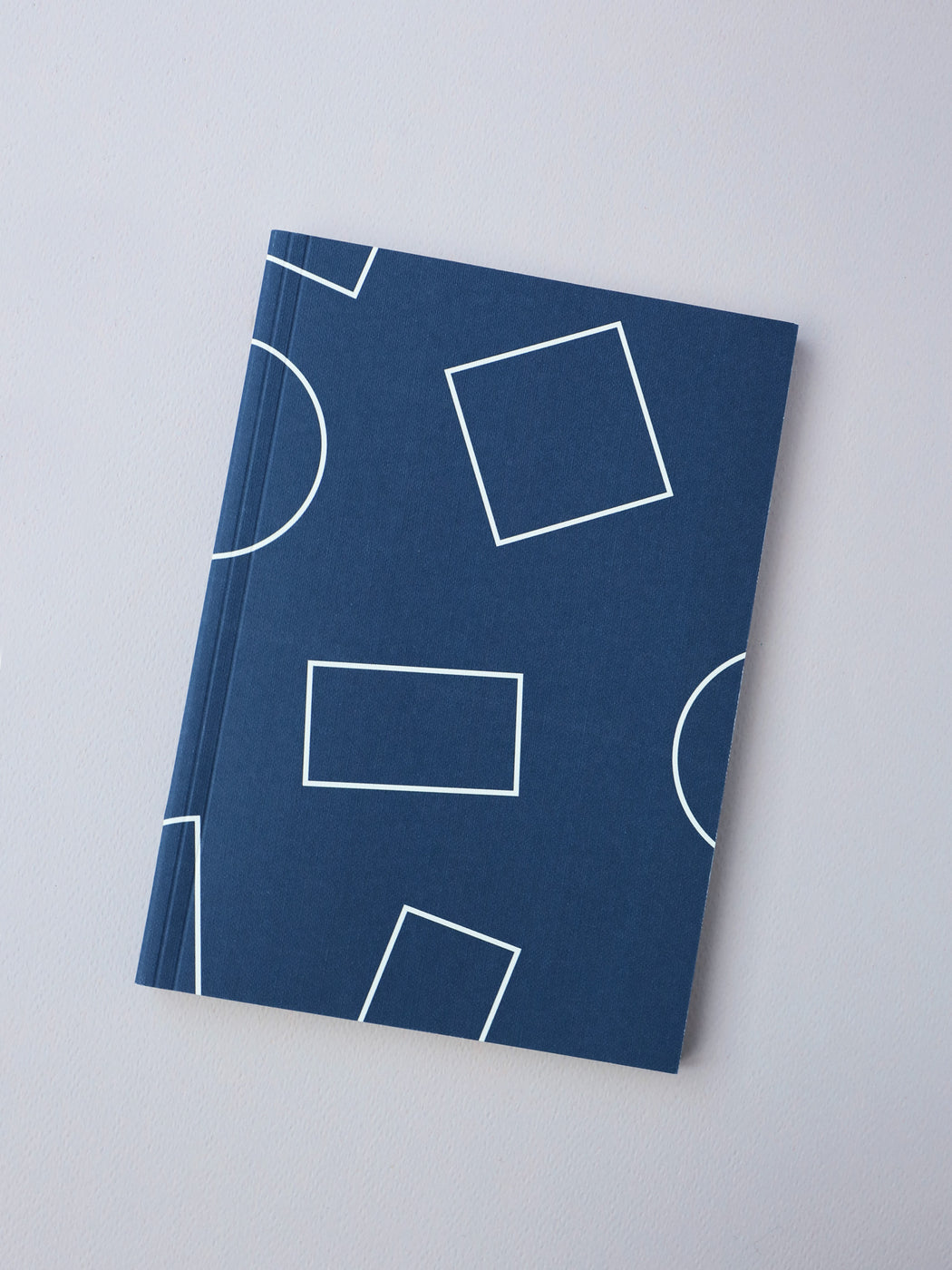 A5 Layflat Week Planner in Navy Shapes Print. Lifestyle curated by Wolf & Moon.