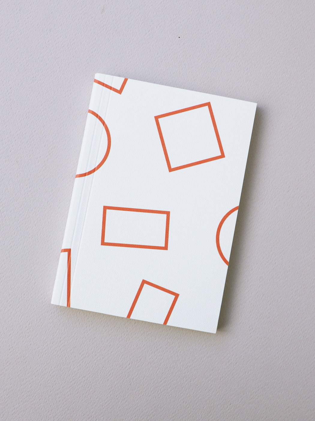 A6 Notebook in Orange Shapes Print