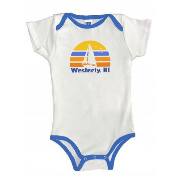White Baby One Piece with Royal Binding featuring a Retro Sun, a sailboat silhouette and the words Westerly, RI.