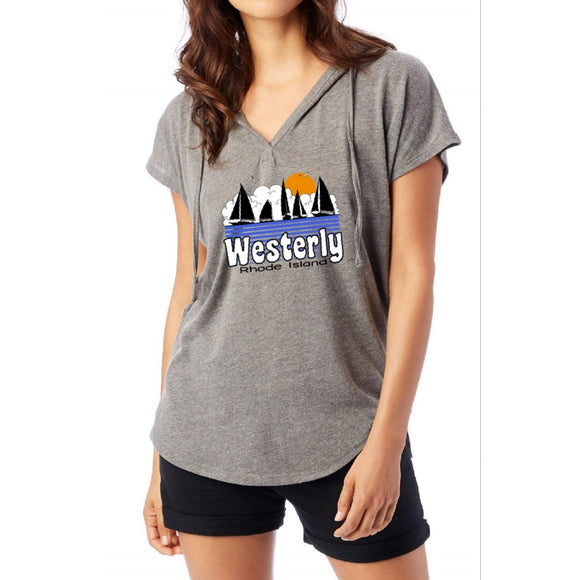 Coal Grey Women's poncho tee with a hood and a picture of multiple silhouettes of sailboats, puffy clouds, linear blue waves and a bubble font reading Westerly Rhode Island.