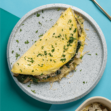 Spinach Omelette with Button Mushrooms, Diced Ham & Gruyere Cheese