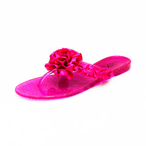 Pink jelly flip flop flops with rosette front