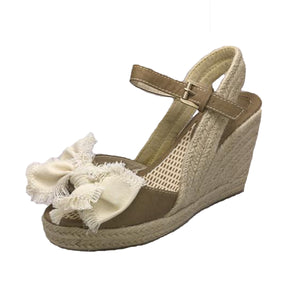 Tan wedge heel sandals with frayed canvas bow