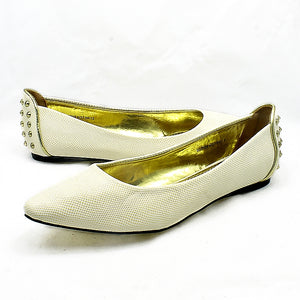 Pointed toe flat shoes with studded detail to back