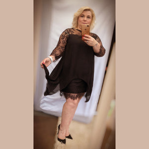 Black fitted dress with loose lace overlay
