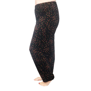Black elasticated waist trousers with orange / multi coloured spots