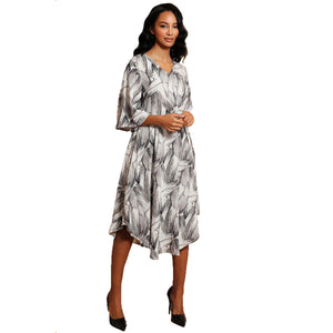 Black + White fluted sleeve dress with Moon shaped hem