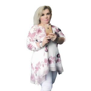 White loose fitting top with butterfly pattern