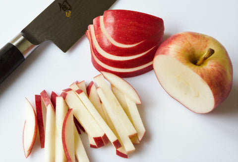 Slice apples and coat with dressing