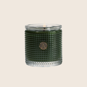 Smell of the Tree® Textured Glass Candle brings the outside in with the fragrance of freshly cut wild evergreen. Our candles are all hand-poured in Arkansas. Made with a proprietary wax blend, ethically sourced containers and cotton wicks. Light one of these aromatic candles and transport yourself to a memory or emotion.