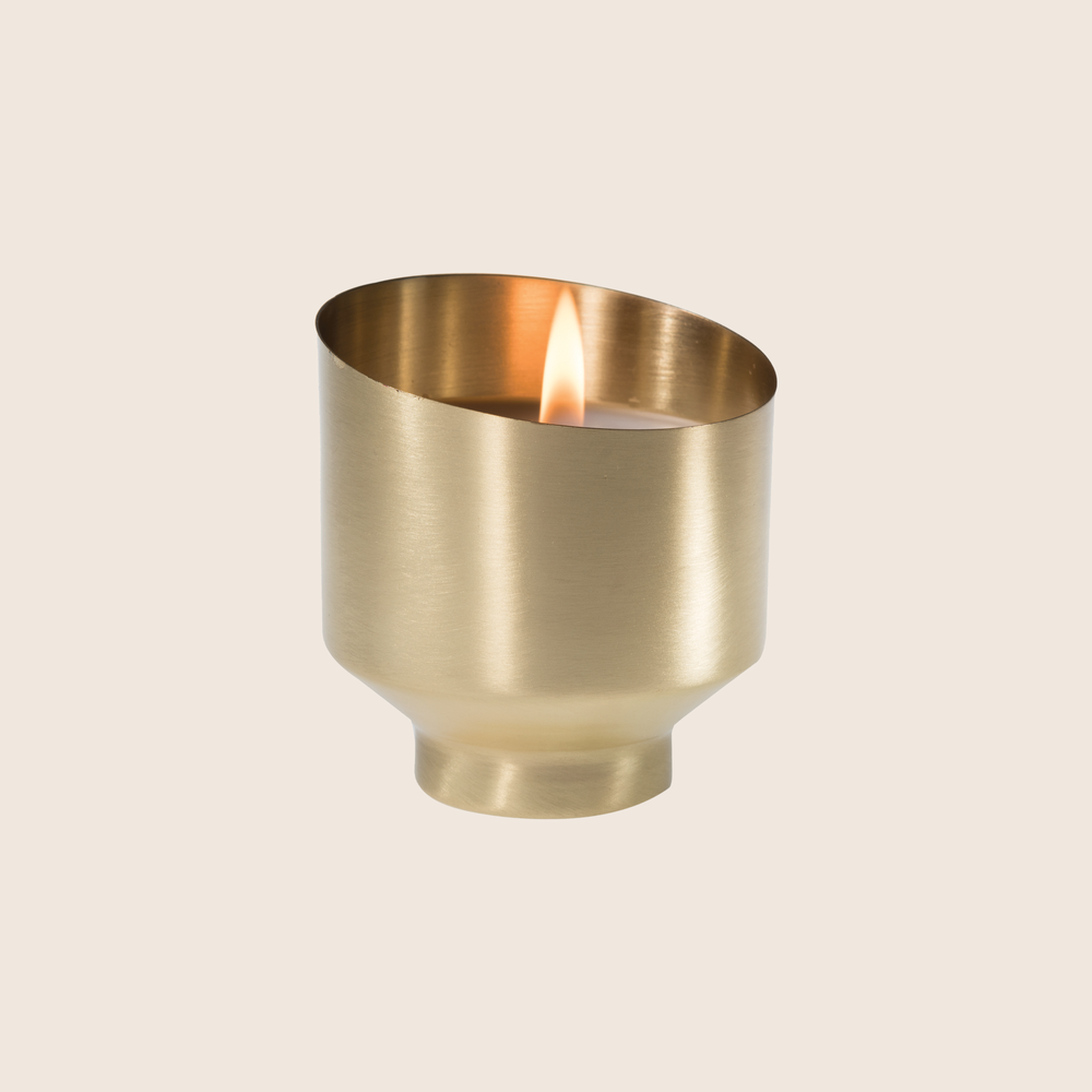 Release. Quietly unwind with this calming fragrance that balances your mind and spirit. Our Lavender Sage Brass Votive Candle was designed to bring luxury and wellness together. Made with beautifully aged brass, and using quality ingredients such as coconut blend wax and essential oil blend fragrances, this candle encompasses style and dedicated self care.