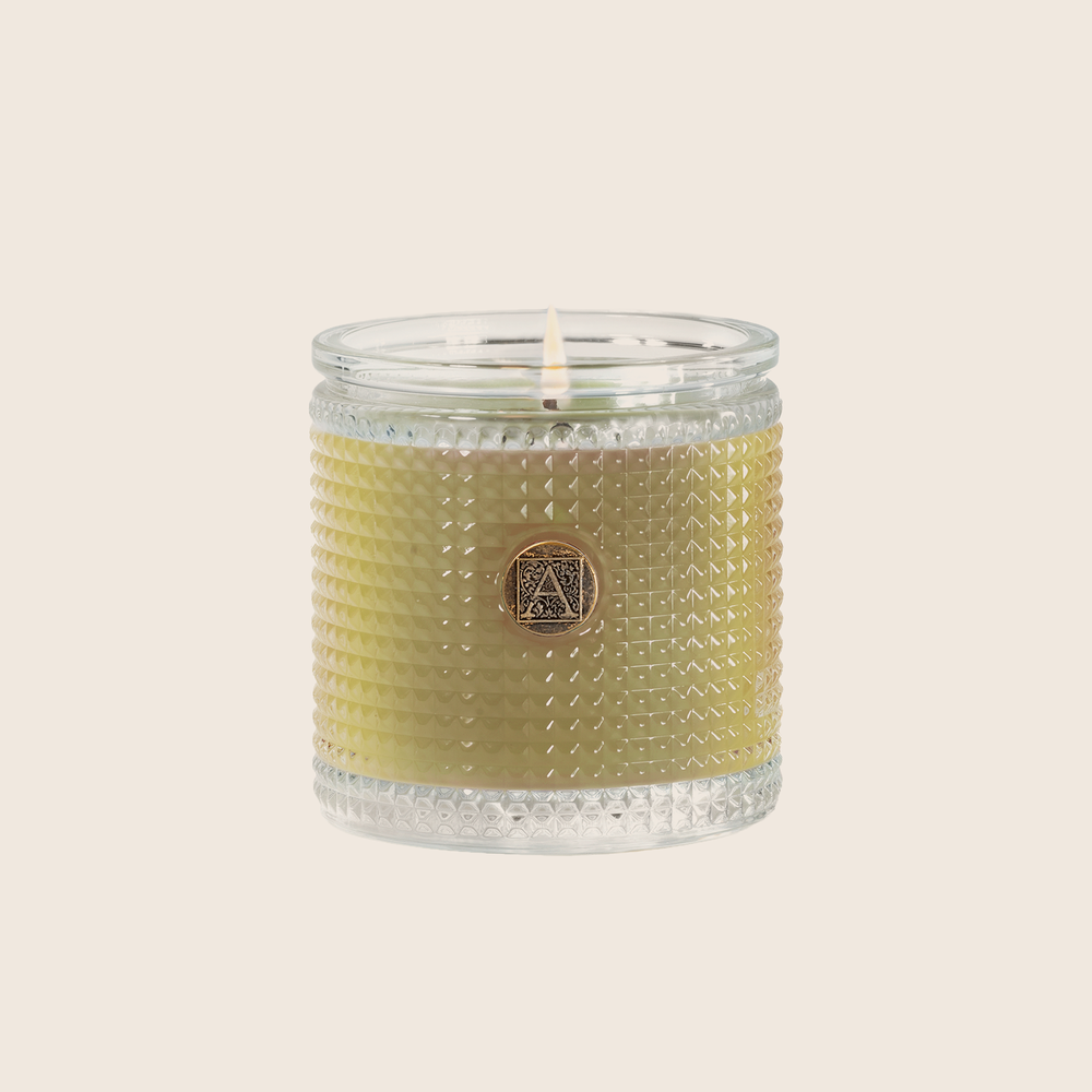 Load image into Gallery viewer, Tangy citrus notes blended with cassis and peach, accented with rose and musk, make the Grapefruit Fandango Textured Glass Candle a bright and cheery addition to any space. Our candles are all hand-poured in Arkansas. Made with a proprietary wax blend, ethically sourced containers and cotton wicks. Light one of these aromatic candles and transport yourself to a memory or emotion.