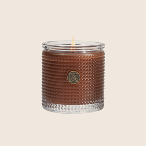 An exquisite blend of cinnamon and spices mixed with apples and a touch of citrus, makes the Cinnamon Cider® Textured Glass Candle the quintessential fall candle. Our candles are all hand-poured in Arkansas. Made with a proprietary wax blend, ethically sourced containers and cotton wicks. Light one of these aromatic candles and transport yourself to a memory or emotion.