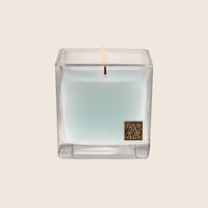 Load image into Gallery viewer, The Cotton Ginseng Cube Candle is fresh and light, with notes of cotton blended with jasmine, eucalyptus, and lavender florals enveloped with sandalwood and musk. Our candles are all hand-poured in Arkansas. Made with a proprietary wax blend, ethically sourced containers and cotton wicks. Light one of these aromatic candles and transport yourself to a memory or emotion.