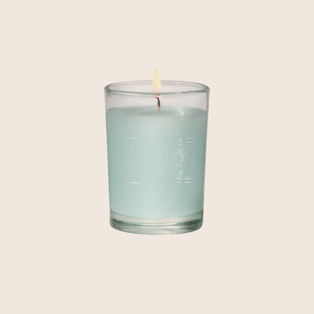 Load image into Gallery viewer, The Cotton Ginseng Votive Candle is fresh and light, with notes of cotton blended with jasmine, eucalyptus, and lavender florals enveloped with sandalwood and musk. Our candles are all hand-poured in Arkansas. Made with a proprietary wax blend, ethically sourced containers and cotton wicks. Light one of these aromatic candles and transport yourself to a memory or emotion.
