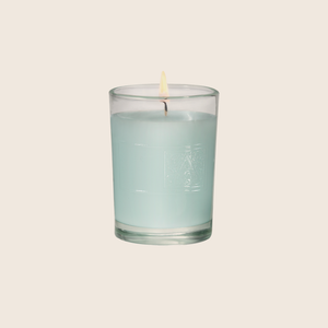 The Cotton Ginseng Votive Candle is fresh and light, with notes of cotton blended with jasmine, eucalyptus, and lavender florals enveloped with sandalwood and musk. Our candles are all hand-poured in Arkansas. Made with a proprietary wax blend, ethically sourced containers and cotton wicks. Light one of these aromatic candles and transport yourself to a memory or emotion.
