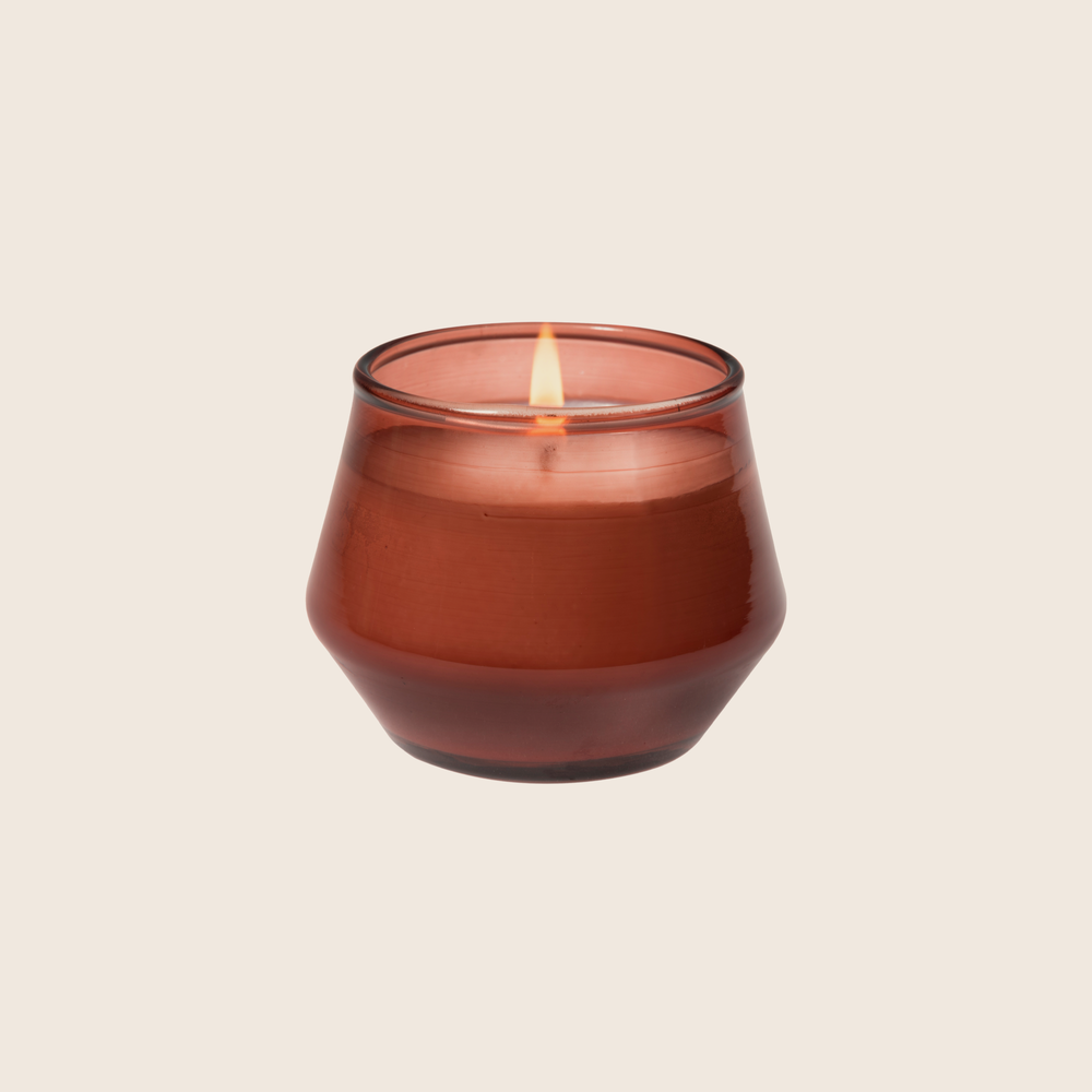 Load image into Gallery viewer, Blood Orange & Sake fills your space with tart blood orange and grapefruit topped with refreshing sake and undertones of green tea leaves. Using coconut blend wax and cotton core wicks encompasses the natural elements that the Urban Gardener values. The terra tinted glass candle is a unique, yet neutral vessel and allows this candle to be used anywhere. Blood Orange & Sake is the perfect everyday staple to bring outdoor inspirations inside.