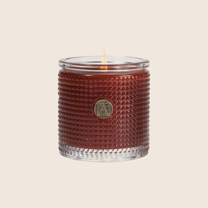 The Pumpkin Spice Textured Glass Candle is brimming with notes of spiced pumpkin and accented with ribbons of vanilla, maple, and cherry. Our candles are all hand poured in Arkansas. Made with a proprietary wax blend, ethically sourced containers and cotton wicks. Light one of these aromatic candles and transport yourself to a past memory or emotion.