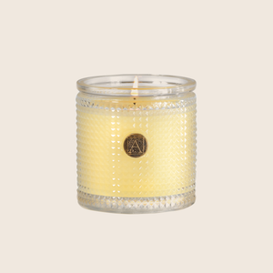 "The Sorbet Textured Glass Candle is fragranced with elements of lemon and lime entwined with peach, melon, and rose. Our candles are all hand-poured in Arkansas. Made with a proprietary wax blend, ethically sourced containers and cotton wicks. Light one of these aromatic candles and transport yourself to a memory or emotion.  Directions: Always burn on a heat resistant surface and trim wick to 1/4"" before each use. Allow wax to pool to the edge each burn for maximum use and to avoid tunneling."