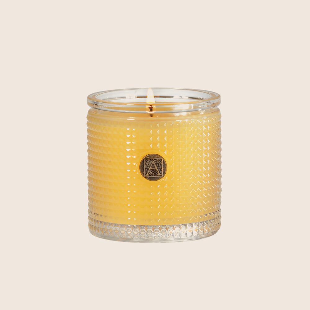 Load image into Gallery viewer, The Agave Pineapple Textured Glass Candle has a lush, fruity floral blend of pineapples and rosewood paired with sweet agave and jasmine fragrance. Our candles are all hand-poured in Arkansas. Made with a proprietary wax blend, ethically sourced containers and cotton wicks. Light one of these aromatic candles and transport yourself to a memory or emotion.