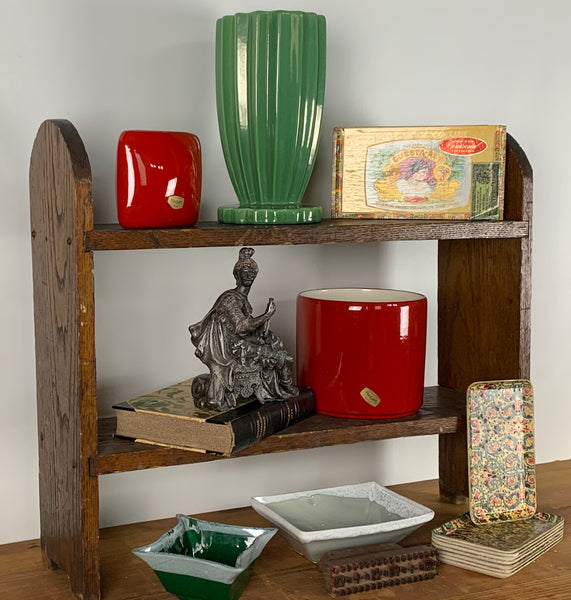 Vignette with flower pots, trays and shelf