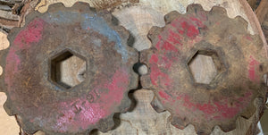 Two metal gears with traces of red paint