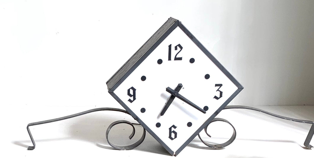 Diamond Shape Outdoor Clock from a Marquee