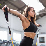 Woman training with resistance bands set