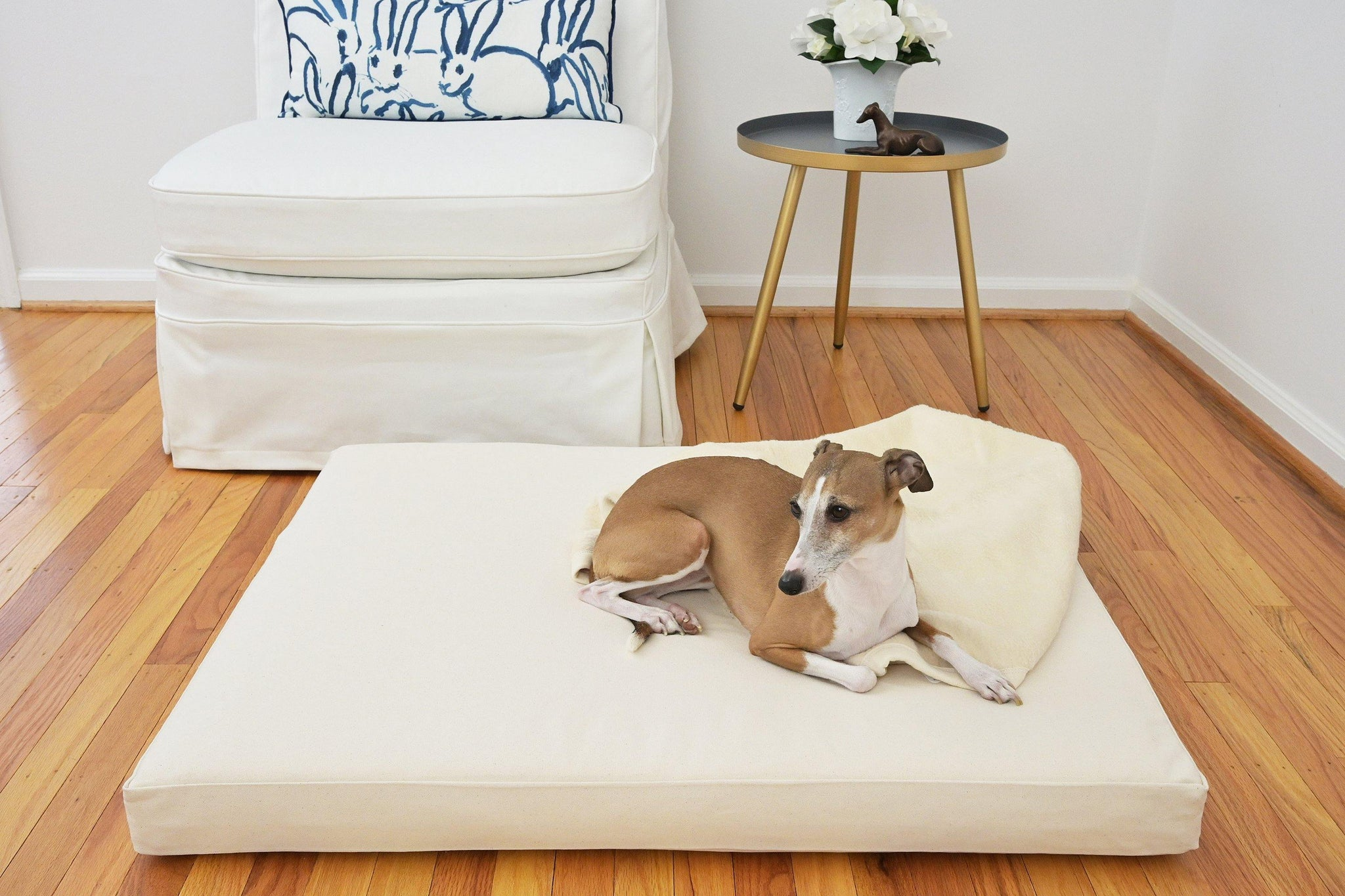 greyhound laying on orthopedic dog bed natural beige