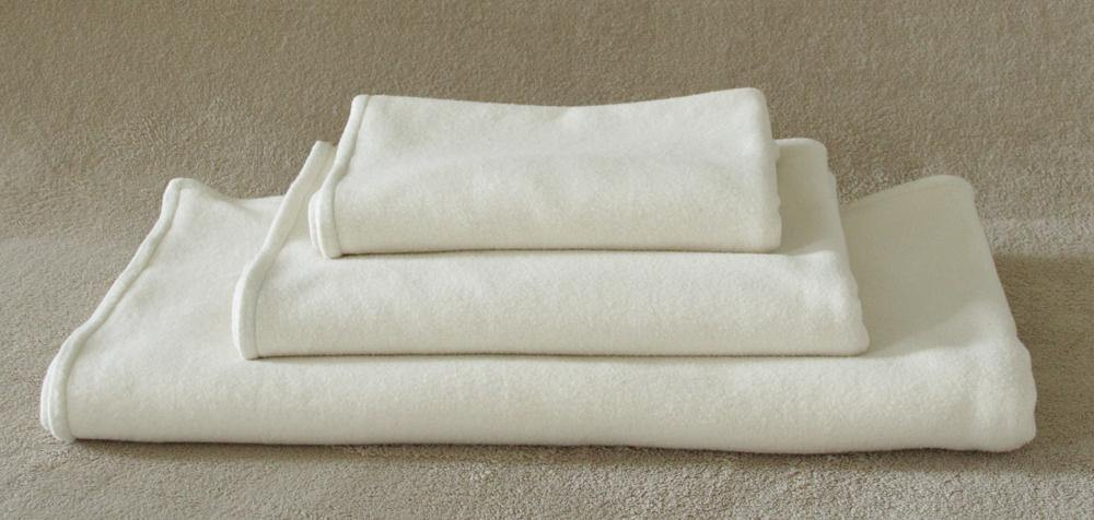 stack of organic cotton natural fleece dog blankets