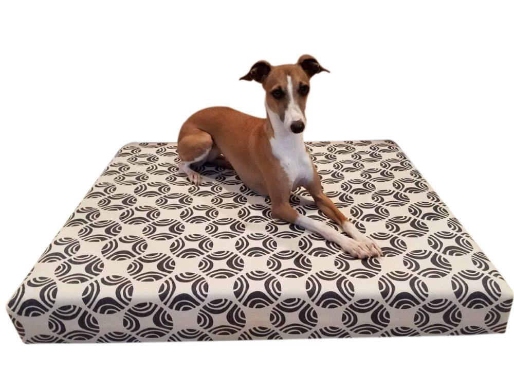 small dog on grey and natural dog bed cover