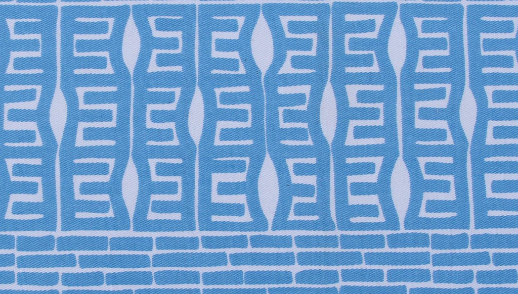 organic cotton fabric close up in blue geometric pattern