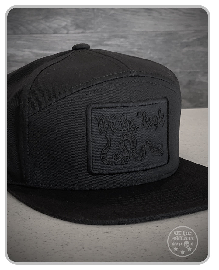 "Black Murdered Out ""We the People"" SnapBack 7 Panel Hat"