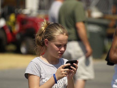 Young girl on cell phone being tracked.