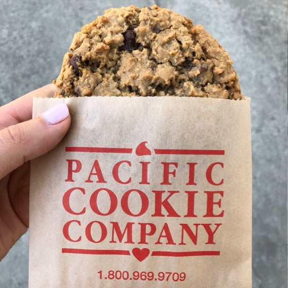 A cookie in a branded Pacific Cookie Company bag