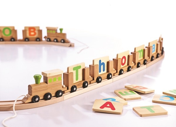Bamboo name train is a great gift for little people. Each carriage comes with a wooden letter - upper case one side and lower case the other side. With an engine on the front this name train can be pulled around. Each carriage with letter is $6.95. Engine is $ 7.95 Individual name can be designed. Recommended for age 3+