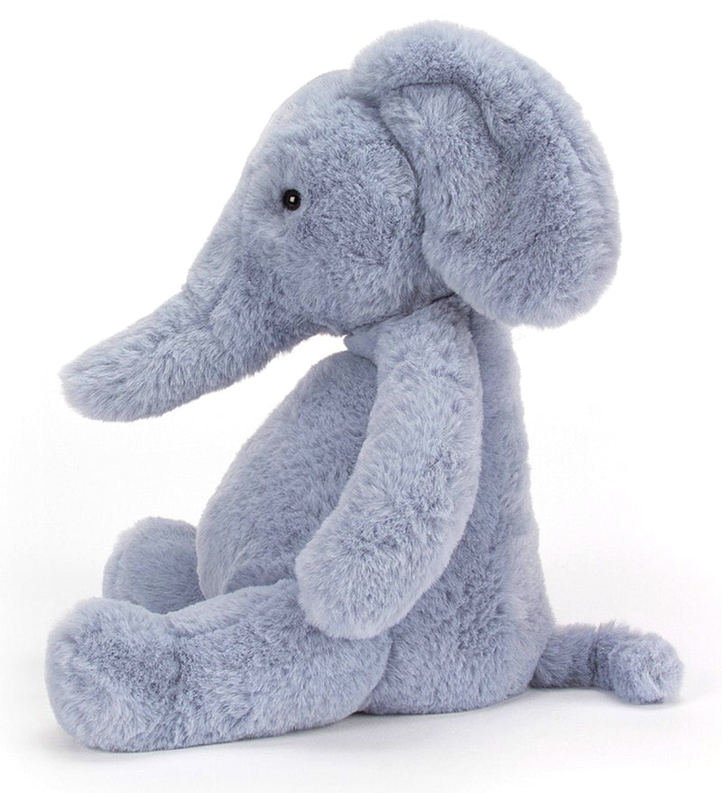 Sound the trumpets - Puffles Elephant is in town! Baby-blue and cloudy-soft, this loveable elly has the scrummiest belly, and loves to tumble around the garden. With a beany bottom and huggable trunk, our bubbly elephant sits so well, looking pastel-perfect