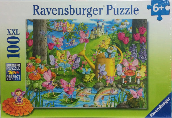 ravensburger puzzle for children age 6+. Beautiful image of a fairy playground with colorful fairies, magical fish , castle in the background and full of colourl.