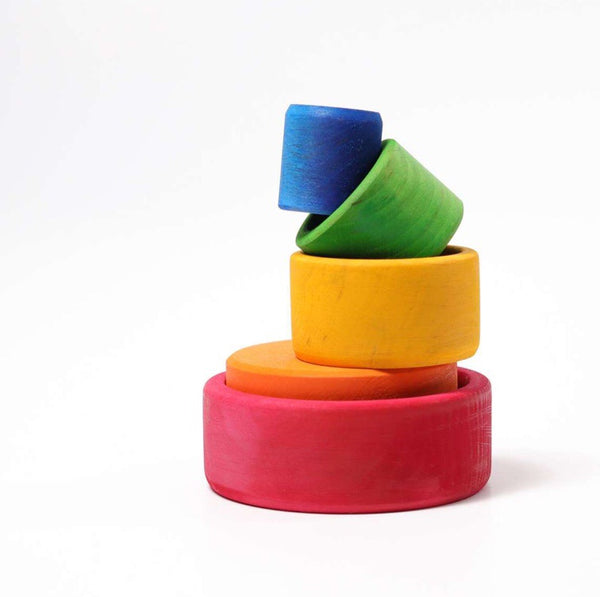 Grimm's wooden coloured bowls for stacking play and recommended for ages 1+.