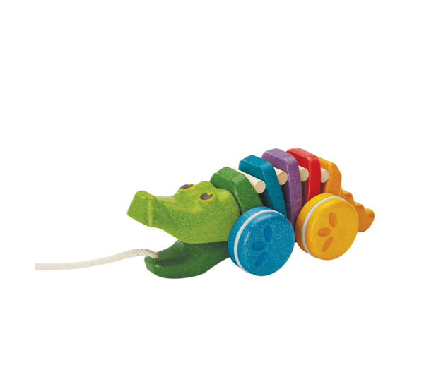 Plan Toys Alligator is an active first pull along toy for ages 1+. A colouful body & and a click-clack sound when it moves.