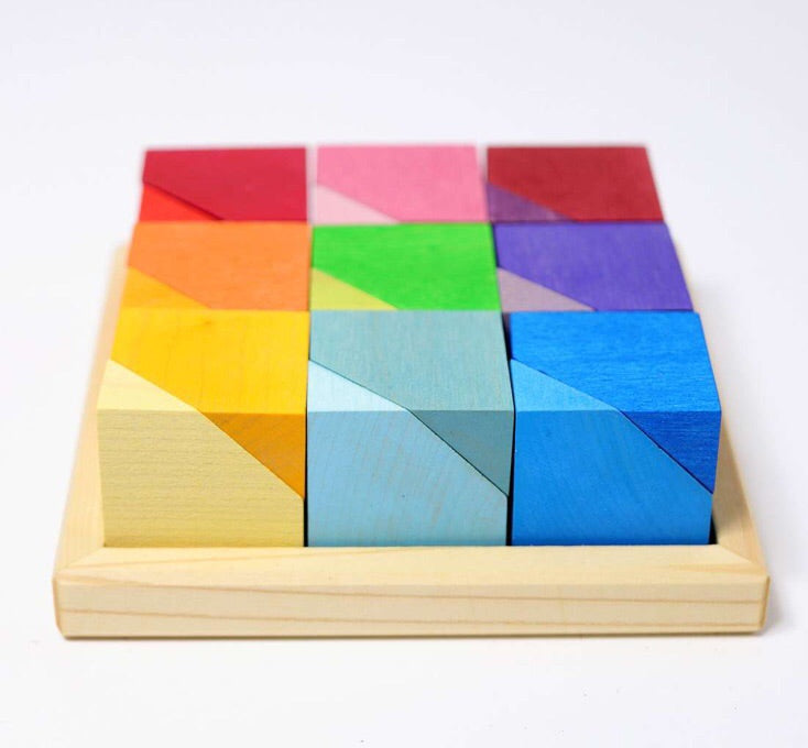 Gorgeous blocks stacked in wooden tray. Grimms multicolour wooden toys