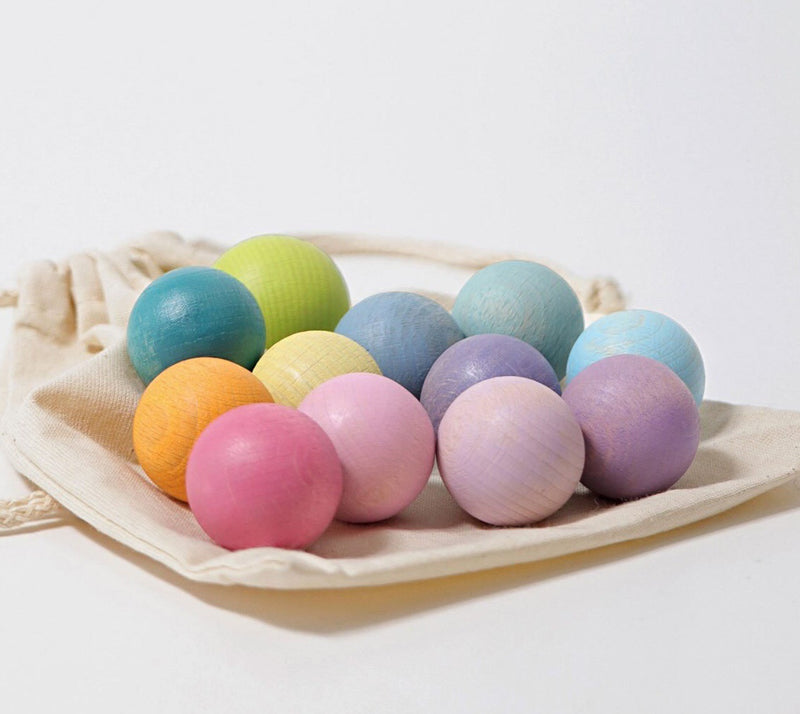 Grimms Pastel wooden balls. Beautiful colours. Comes with a Calico bag