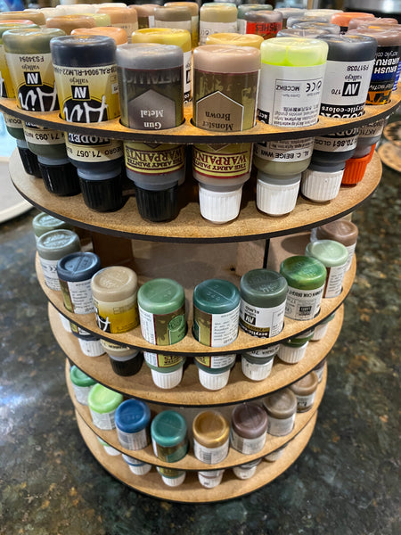 Paint storage for dropper bottle paints.