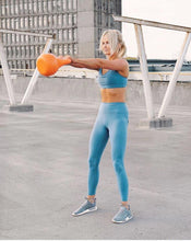 Load image into Gallery viewer, Woman doing kettlebell swing with 8kg kettlebell