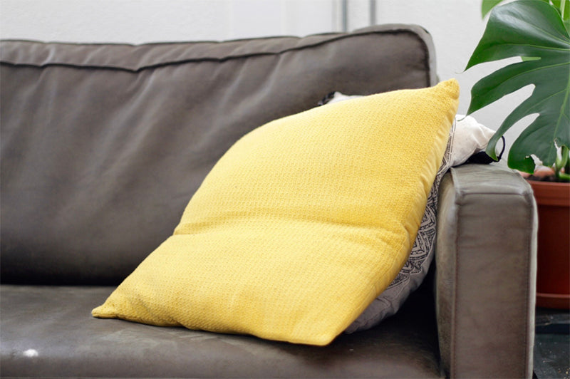 Scatter Cushions Hide Flaws on Used Furniture