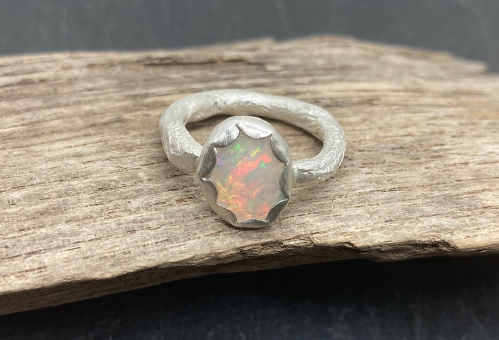 Ethiopian opal silver ring with a textured heavy band