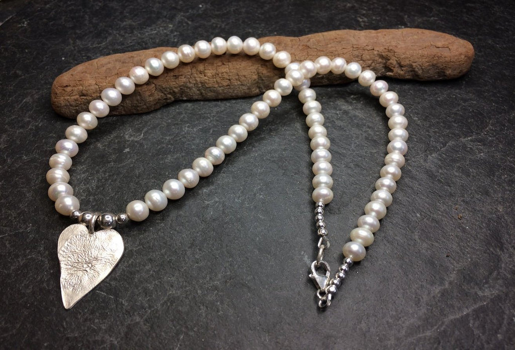 Freshwater pearl necklace with a silver heart pendant.