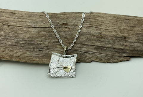 Silver and gold  textured pendant